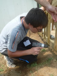 Logan working hard on our 2011 Family Mission Trip